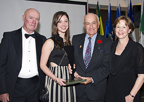 Doug Henry was inducted into the Jump Canada Hall of Fame in the category of Builder (Individual) in a special ceremony, presented by BMO Financial Group, on November 2 at The Royal Agricultural Winter Fair in Toronto, ON. Jim Henry, Kaitlin Henry Armstrong, and Nancy Armstrong accepted the award from Jim Elder (second from right) on behalf of Doug Henry. Photo by Michelle C. Dunn