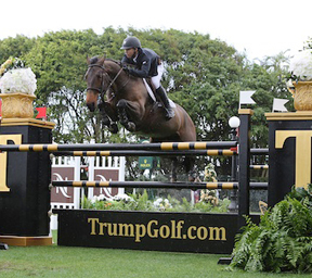 Kent Farrington and Blue Angel won the $125,000 Trump Invitational Grand Prix CSI 2*. Photo by © Sportfot, www.us.sportfot.com.