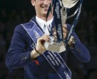 All mine! Germany's Daniel Deusser looks with delight at the Longines FEI World Cup™ Jumping trophy which he won today following a superb performance with Cornet d'Amour. Photo by FEI/Dirk Caremans