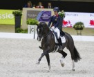 Great Britain's Charlotte Dujardin and the brilliant gelding Valegro set yet another new world record when scoring 87.129 to win today's Grand Prix at the Reem Acra FEI World Cup™ Dressage 2013/2014 Final in Lyon, France. Photo by FEI/Dirk Caremans.