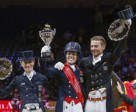 Great Britain's Charlotte Dujardin (centre) claimed the Reem Acra FEI World Cup™ Dressage 2014 title at Lyon, France today after a spectacular Freestyle performance with Valegro. Pictured with her on the prize-winner's podium are (left) runner-up Germany's Helen Langehanenberg and (right) third-place Edward Gal from The Netherlands. Photo by FEI/Dirk Caremans