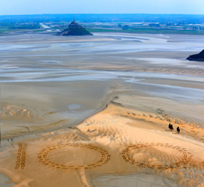 Giant 2.3m by 2.5m horse hoof prints created in the Bay of Mont-Saint-Michel, the famous UNESCO World Heritage Site, by French artist and sand sculptor Christophe Dumont, mark 100 days to the start of the Alltech FEI World Equestrian Games™ 2014 in Normandy, France this summer. (Photo: Dan Towers/FEI).