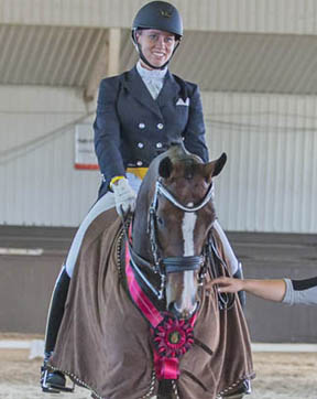 At the International Dressage Tournament CDI 3* Cedar Valley, held June 19-22, 2014 in Cedar Valley, ON, Canada's young dressage talent, Megan Lane, won both the Grand Prix and Grand Prix Special. Photo by Mary White, Lone Oak Equine Photography