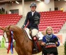 Shawna Dunn and her mount Leilani won the five-year-old championship of the $15,000 Jump Alberta Western Canadian Young Horse Championships at the Royal West Tournament. Photo by Anna Skripets Photography.