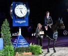 Great Britain's William Whitaker pictured with Longines representative Christiane Becherer after his victory with Fandango in today's Longines FEI World Cup™ Jumping 2014/2015 Western European League qualifier at Stuttgart, Germany. Photo by FEI/Karl-Heinz Freiler