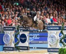 Marco Kutscher and Cornet's Cristallo in the seventh leg of the Longines FEI World Cup™ Jumping 2014/2015 Western European League at Olympia. Photo by the FEI