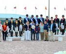 On the podium for the second leg of the FEI Nations Cup™ Dressage 2015 series in Wellington, USA (from left) - third-placed Team Canada 2, Jill Irving, Tina Irwin, Christilot Boylen and Shannon Dueck; the winners, Team USA 1, Kimberly Herslow, Allison Brock, Laura Graves and Olivia LaGoy-Weltz; and second-placed Team Canada 1, Diane Creech, Belinda Trussell, Chris Von Martels and Megan Lane. In the foreground, Arlene Page, Robert Dover, Debbie MacDonald, Diane Sasser, Allyn Mann and Thomas Bauer. Photo by FEI/Susan Stickle