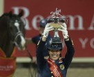 Great Britain's Charlotte Dujardin holds the new Reem Acra trophy aloft after making it a back-to-back double of victories with the amazing Valegro at the Reem Acra FEI World Cup™ Dressage 2015 Final in the Thomas & Mack arena in Las Vegas, USA. Photo by FEI/Dirk Caremans