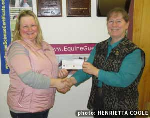 Nancy Kavanagh, Ontario's EFC representative and secretary presents $16,000 cheque to Equine Guelph director, Gayle Ecker. Photo by Henrietta Coole