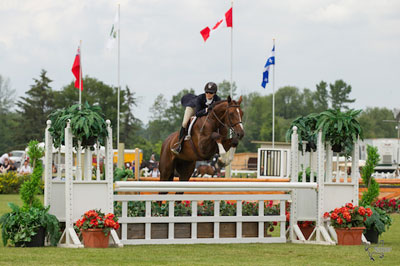 Ainsley Vince of Burlington, ON, and Magic Show, owned by Knightwood Stables, on their way to victory in the $10,000 Canadian Hunter Derby at the Ottawa International at Wesley Clover Parks. Photo by Ben Radvanyi Photography