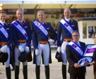 The Dutch team celebrate victory in the third leg of the FEI Nations Cup™ Dressage 2015 pilot series in Rotterdam, The Netherlands (L to R): Edward Gal, Diederik van Silfhout, Patrick van der Meer and Hans Peter Minderhoud. Dutch Chef d'Equipe, Wim Ernes, accepts the trophy from Show President, Belle de Bruin. Photo by FEI/Arnd Bronkhorst