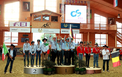 The Junior Team podium at the FEI European Reining Championships for Juniors and Young Riders 2015 at Givrins, Switzerland (L to R): the silver medallists from Italy, gold medallists from Germany and bronze medallists from Belgium. Photo by FEI/Andrea Bonaga