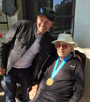 Eric Lamaze and Eddie Creed share a special moment after Lamaze's team gold medal win at the TORONTO 2015 Pan American Games on July 23.