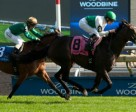 Emma-Jayne Wilson (white and green silks) guides Habibi (NZ) to victory in the $100,000 Flaming Page Stakes at Woodbine. Photo by Michael Burns Photography