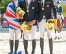 Individual medallists (L to R) Great Britain's Sophie Beaty (silver), Great Britain's Will Furlong (gold) and Germany's Christoph Wahler (bronze). Photo by FEI/Leszek Wójcik