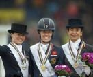 The Grand Prix Freestyle medallists on the podium at the FEI European Dressage Championships 2015 in Aachen, Germany today. (L to R) Kristina Bröring-Sprehe from Germany (silver), Britain's Charlotte Dujardin (gold) and Spain's Beatriz Ferrer-Salat (bronze). Photo by FEI/Dirk Caremans