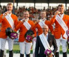 The Netherlands' (L to R) Jur Vrieling, Gerco Schroder, Maikel van der Vleuten and Jeroen Dubbeldam with Chef d'Equipe Rob Ehrens celebrate team gold at the FEI European Jumping Championships 2015 in Aachen, Germany. Photo by FEI/Dirk Caremans