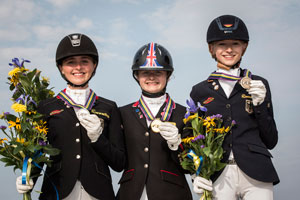On the podium for the individual Dressage Championship at the FEI European Pony Championships 2015 in Malmo, Sweden: (L to R) silver medallist Nadine Krause (GER), gold medallist Phoebe Peters (GBR) and bronze medallist Helen Erbe (GER). Photo by FEI/LottaPictures AB