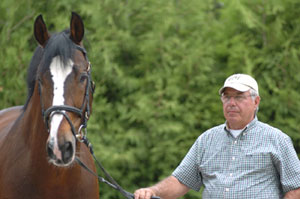 Rio Grande, pictured with owner Augustin Walch, will be inducted into the Jump Canada Hall of Fame on Sunday, November 8, 2015. Photo Courtesy of Michelle C. Dunn