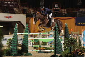 "Conor Swail rode Lothlorien Farm's Simba De La Roque to victory Thursday night in the $40,000 Pennsylvania National ""Big Jump"" class at the Pennsylvania National Horse Show. Photo by Al Cook"
