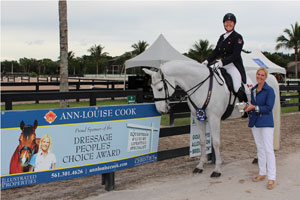 Ann-Louise Cook presents Jacqueline Brooks with the People's Choice Award at the first competition of the 2016 Adequan Global Dressage Festival. Photo by Cora Causemann