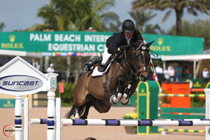 Shane Sweetnam and Buckle Up won the $35,000 Suncast® 1.50m Championship Jumper Classic. Photo by Sportfot