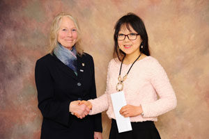 Dr. Mary Bell presents the Caird F. Wilson Graduate Scholarship to Olivia Lee.