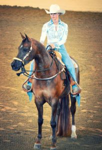 Danielle riding her horse, Marquis, at U.S. Nationals doing a victory pass after winning a national title. Photo by Sharon Chuchran