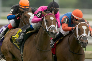 Patrick Husbands guides #6 Lexie Lou (pink silks black cap) to victory in the $200,000 Nassau Stakes at Woodbine. Photo by Michael Burns Photography