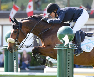 Lisa Carlsen and Worlds Judgement were second in the $175,000 CNOOC Nexen Cup Derby at the Spruce Meadows National. Photo by Spruce Meadows Media Services