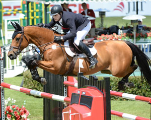 Peter Lutz (USA) and Robin de Ponthual won the $375,000 CP Grand Prix at the Spruce Meadows Continental. Photo by Spruce Meadows Media Services