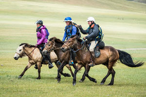 Heidi Telstad of British Columbia (middle) is at the final horse station before the finish in the Mongol Derby. Photo by Richard Dunwoody