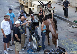 Tommie's horse, Blade, is being ridden by Andrew Lincoln (aka Rick) in episode one of The Walking Dead. Tommie can be seen behind the camera man, acting as the stunt double.