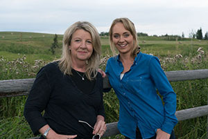 Heather Conkie, executive producer of CBC's Heartland, with Amber Marshall, who plays Lou Fleming