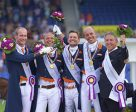 Wim Ernes, Olympic Dressage judge and Dutch team coach, has passed away at the age of 58. He is pictured here (far right) celebrating with (left to right) his gold medal winning team of Diederik van Silfhout, Patrick van der Meer, Edward Gal and Hans Peter Minderhoud at the FEI European Championships 2015 in Aachen (GER). Photo by Arnd Bronkhorst