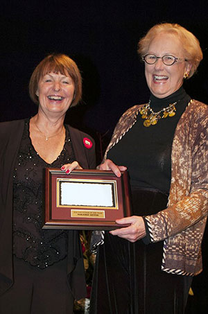 Marjorie Dennis of Caledon, ON was named the 2016 Greenhawk Jump Canada Volunteer of the Year in recognition of her longstanding dedication and invaluable contributions to hunter/jumper sport in Canada. She accepted the award from Pamela Law, Chair of Jump Canada, during the Jump Canada Hall of Fame Gala on Nov. 6 in Toronto, ON. Photo by Michelle Dunn