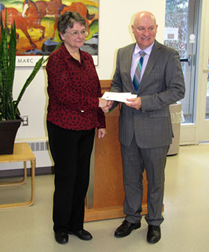 Equine Foundation of Canada treasurer, Susan Nelson, presented a cheque for $127,000 to Atlantic Veterinary College dean, Greg Keefe.