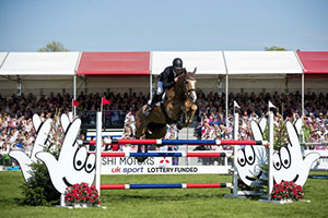 Six time Olympian Andrew Nicholson (NZL) finally wins the coveted Badminton trophy, with Nereo, fourth leg of the FEI Classics™ T, after a record 37 completions. Photo by FEI/Jon Stroud