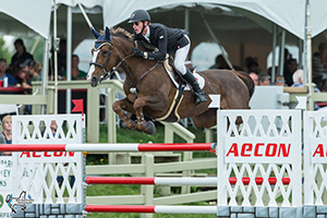 Ireland's Daniel Coyle and his Canadian-bred mount, Tienna, won the $35,000 AECON Jumper Classic to conclude the CSI3* Ottawa International Horse Show on Sunday, July 23, at Wesley Clover Parks in Ottawa, ON. Photo by Ben Radvanyi Photography