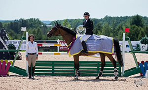 Hilary Donaldson of Leon's making the presentation of awards to Rachel Schnurr and Prince Garbo for their victory of the $25,000 Grand Prix Presented by Leon's. Photo Credit: Ben Radvanyi Photography.