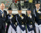 Chef d'Equipe Klaus Roeser (left) with the gold medal winning German Dressage team - Isabell Werth, Dorothee Schneider, Helen Langehanenberg and Sonke Rothenberger - on the podium at the Longines FEI European Championships 2017 in Gothenburg, Sweden. Photo by FEI/Liz Gregg