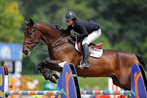 Cassandra Kahle won the $50,000 ULCERGARD Grand Prix aboard WALLSTREET at the HITS-on-the-Hudson VI Summer series finale. Photo by ESI Photography