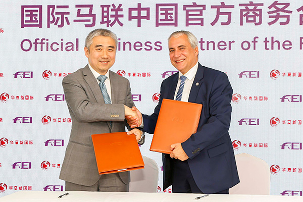 The Fédération Équestre Internationale (FEI), the world governing body for equestrian sport, has announced a brand new partnership with China National Sports International (CNSI), a sports and entertainment company that specialises in equestrian sports in China. Pictured left to right: Sun Liming, Executive Director of China National Sports International with FEI President Ingmar De Vos. Photo by FEI/Yuanpu Xia