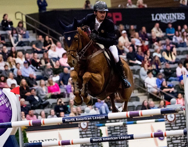 Ireland's Denis Lynch and RMF Echo flying high as they capture a take top class win at the Longines FEI World Cup™ Jumping in Lexington (USA) overnight. Photo by FEI/Ashley Neuhof