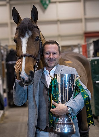 Eric Lamaze and Fine Lady 5, owned by Artisan Farms, with the Rolex IJRC trophy. Photo by ROLEX/Kit Houghton