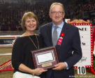 "John ""JT"" Taylor was presented with the 2017 JC Official of the Year Award by Pam Law, Chair of the EC Jumping Committee, at the Royal Horse Show on Nov. 4, 2017 in acknowledgment of his exceptional career as a top FEI Jumping Judge. Photo by Cealy Tetley"
