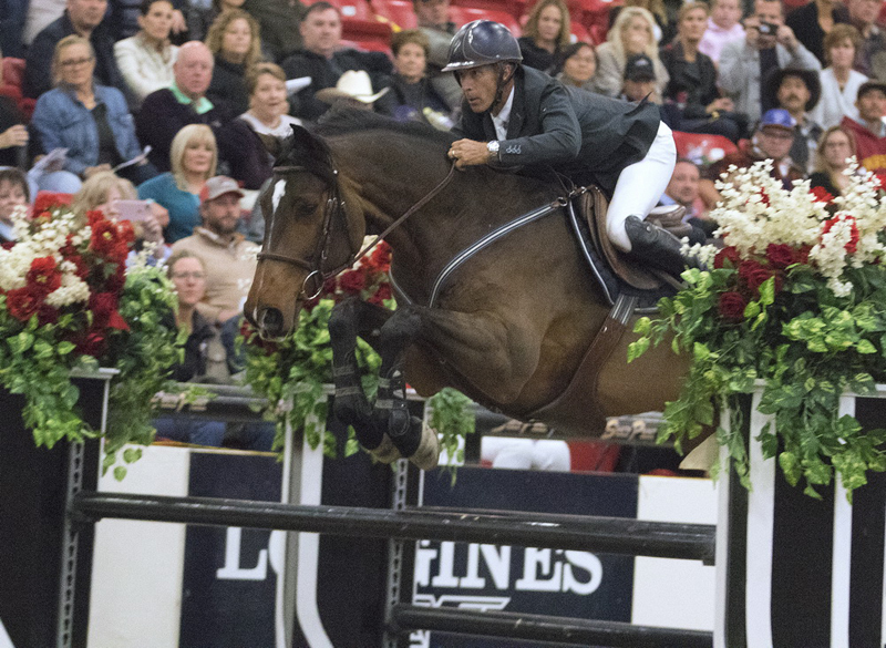 USA's Richard Spooner and Chatinus take flight as they claim victory in the Longines FEI World Cup Jumping Las Vegas (USA)