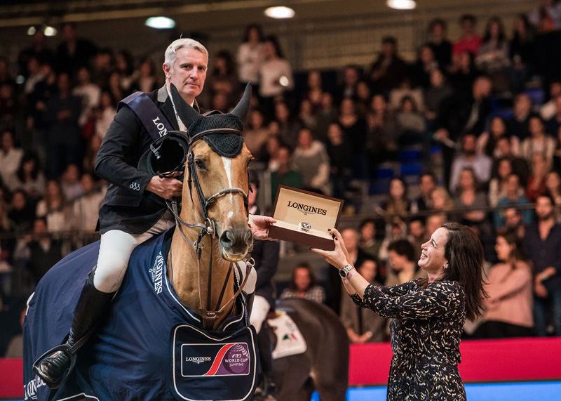 Rio 2016 Olympic team champions, Roger Yves Bost and the mare Sydney Une Prince, pictured with Elena Orozco, Longines brand manager Spain, after winning the sixth leg of the Longines FEI World Cup™ Jumping 2017/2018 Western European League in Madrid (ESP).