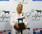 Live Oak's Charlotte Weber accepts World Approval's Eclipse Award on January 25 at Gulfstream Park. Photo by Horsephotos.com/NTRA