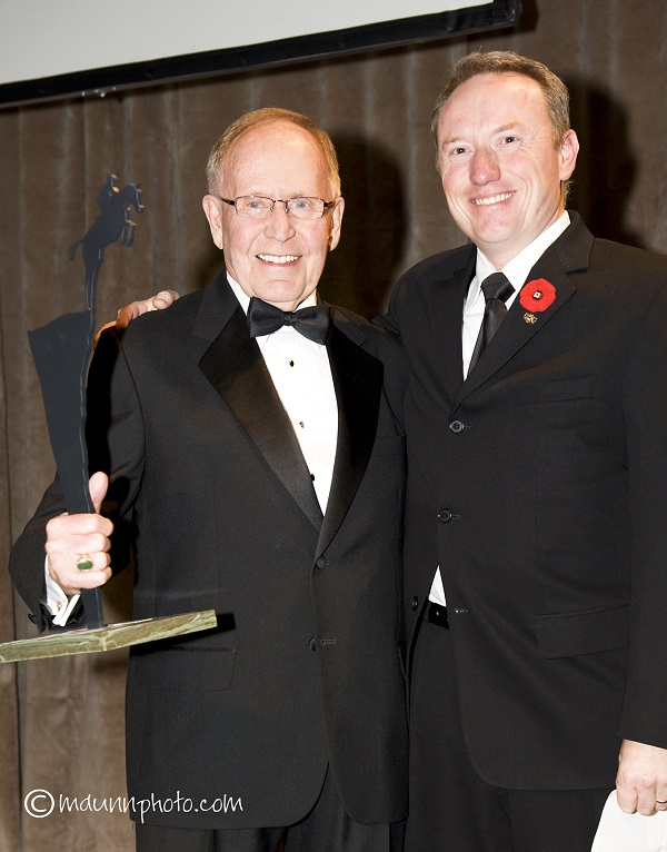 "Gordon ""Tom"" Michiel, pictured with EC Director of Sport, Jon Garner (right) was inducted into the Jump Canada Hall of Fame in 2010. He passed away at the age of 87 on Jan. 22, 2018."